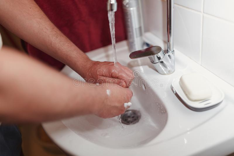 Morning hygiene, Male wash his hands after shaving stock images