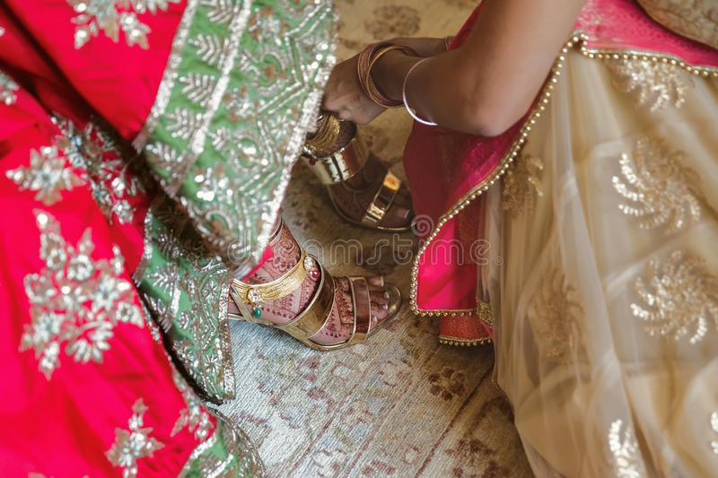 Indian wedding traditions. Indian Bride wear shoes stock photography