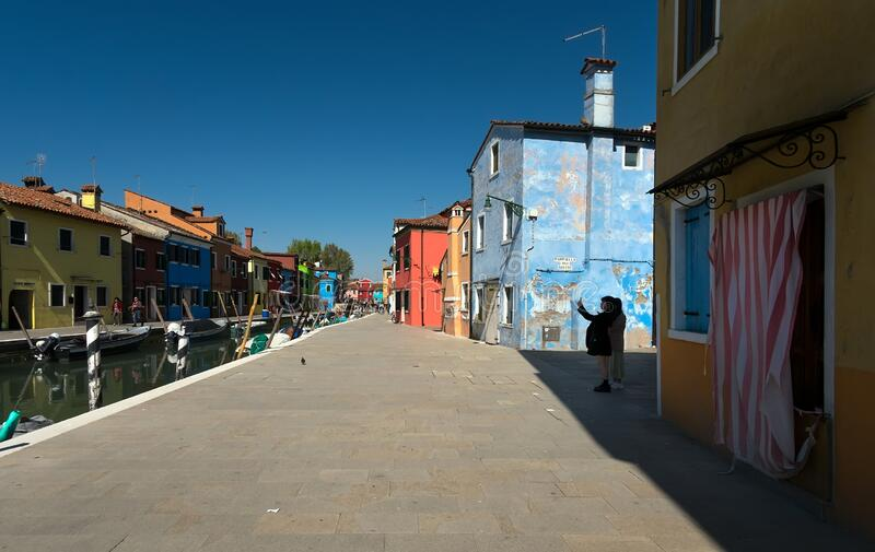 Morning on the island of Burano. Weekdays of the island of Burano. Colored facades. The streets of the old city of Venice. Bright stock photo