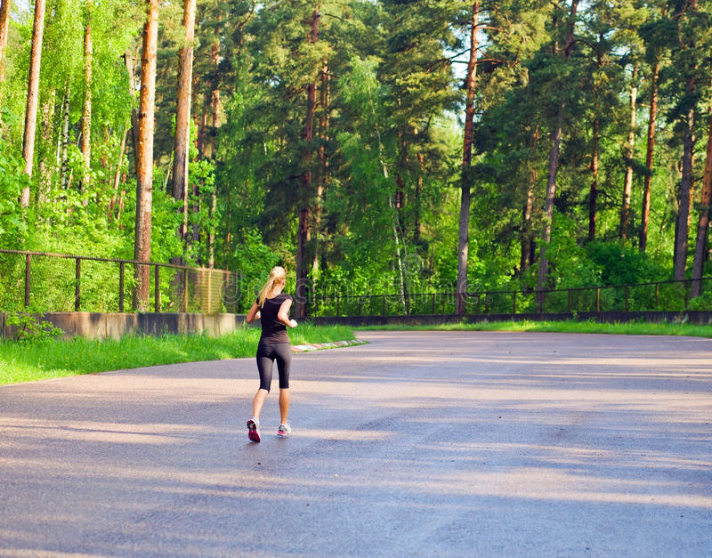 Download Morning Jog In Wood. Royalty Free Stock Photo - Image: 24892805