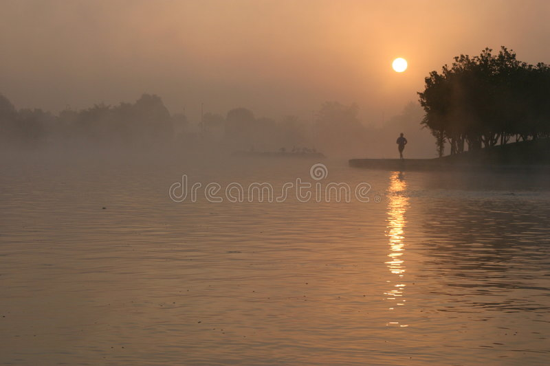 Morning Jogger in the fog stock photography