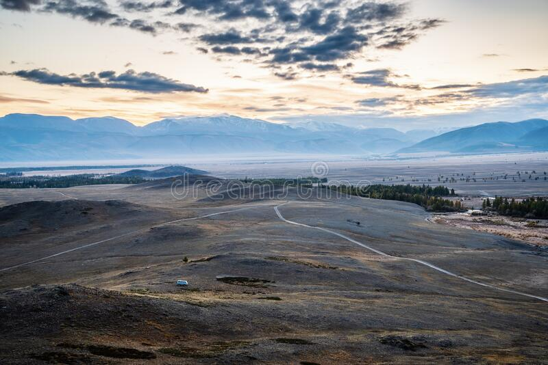 Morning in the Kurai steppe, dirt road through the hills royalty free stock images
