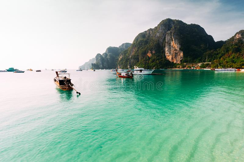 Laguna on the beautiful Thai Islands. Asian Islands. Thai Phi Phi Islands. Thai wooden boats. Boats in the Bay. Excursion to the Islands. Travel to Asia royalty free stock photos