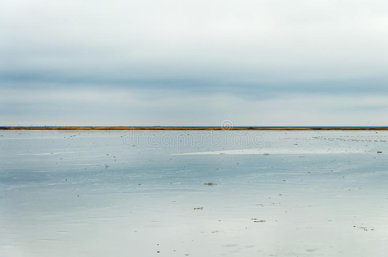 Morning on the lake, the clouds are reflected in the water. Salt Lake Elton, Russia, Volgograd Region. stock photography
