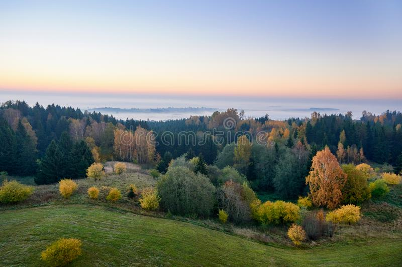 Morning landspace with sun rays. Beautiful landscape with forest and fog.Lithuanian landscape stock photos