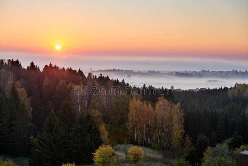 Morning landspace with sun rays. Beautiful landscape with forest and fog.Lithuanian landscape. Morning landspace with sun rays. Beautiful landscape with forest stock image