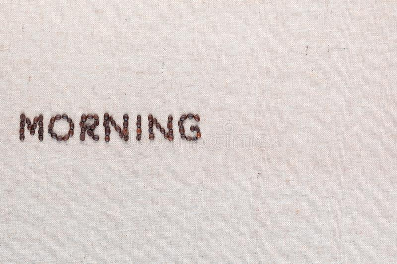 Morning letter sign from coffee beans isolated on linea texture, aligned middle left stock image
