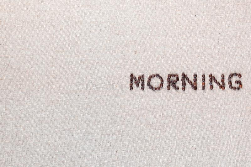 Morning letter sign from coffee beans isolated on linea texture, aligned middle right stock images