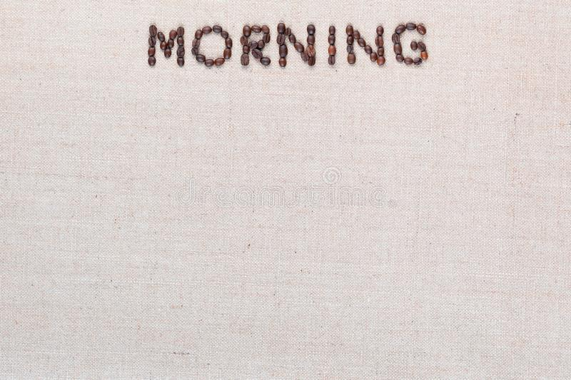 Morning letter sign from coffee beans isolated on linea texture, aligned top center stock photos