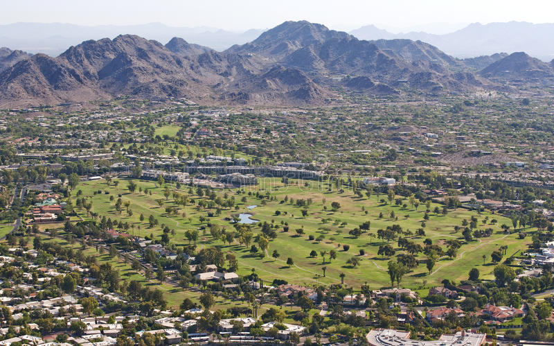 Morning light on desert golf course stock images