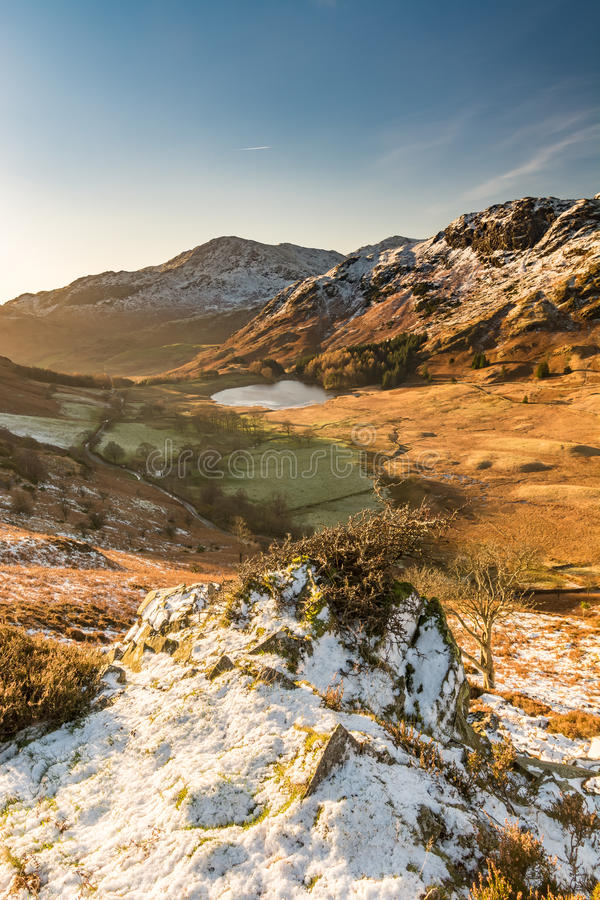 Morning Light Entering Langdale Valley. Morning light entering the Langdale Valley with snow on the Langdale Pikes in the English Lake District royalty free stock photography