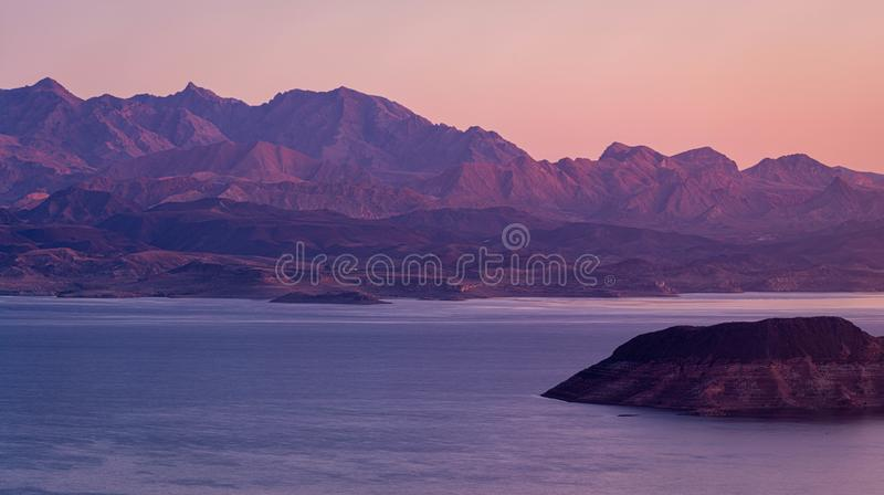 Morning light over Lake Meade. With an island in the foreground and a mountain in that background royalty free stock photo