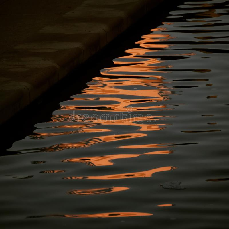 Morning Light reflected onto a Pool of Water stock photography