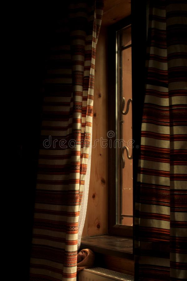 Morning light in the ukrainian room falling through curtains on royalty free stock photography