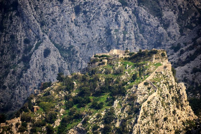 Morning lighted top mountain fortress. Montenegro. This is the unique bird's eye view on the morning lighted outstanding ancient fortress of St John stock photos