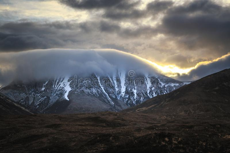 Morning low clouds on Red Cuillin hills in Isle of Skye, Scotland. royalty free stock photo