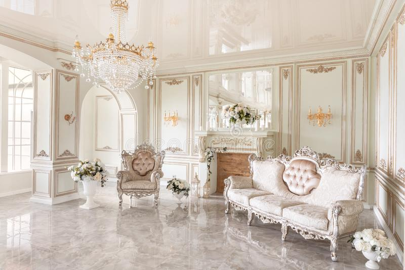 Morning in luxurious light interior in mansion . Bright and clean interior design of a luxury living room with stone. Morning in luxurious light interior in stock photo