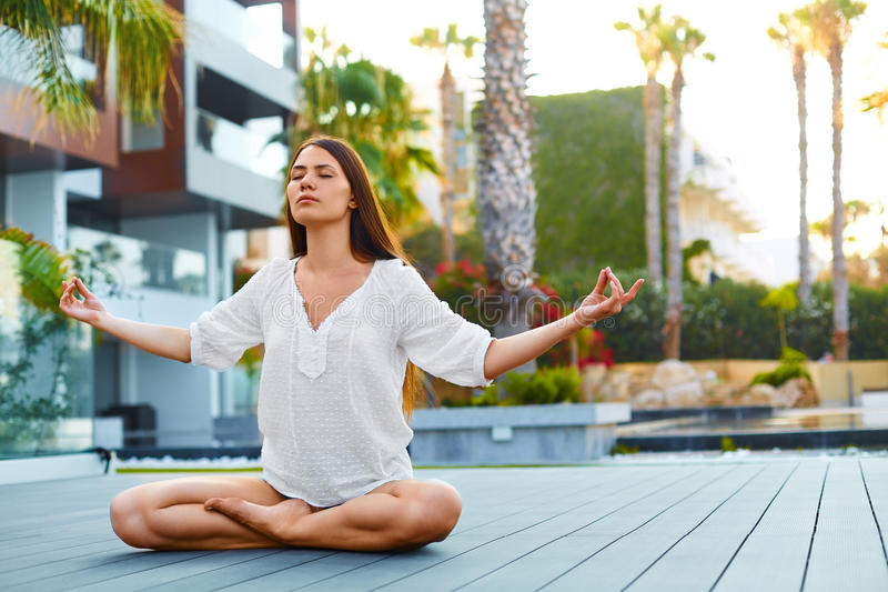 Morning meditation. Healthy woman. stock photo
