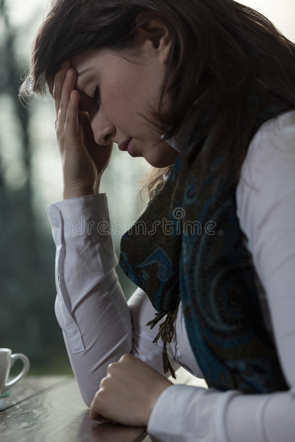 Morning migraine. Young pretty stressed woman with morning migraine royalty free stock images