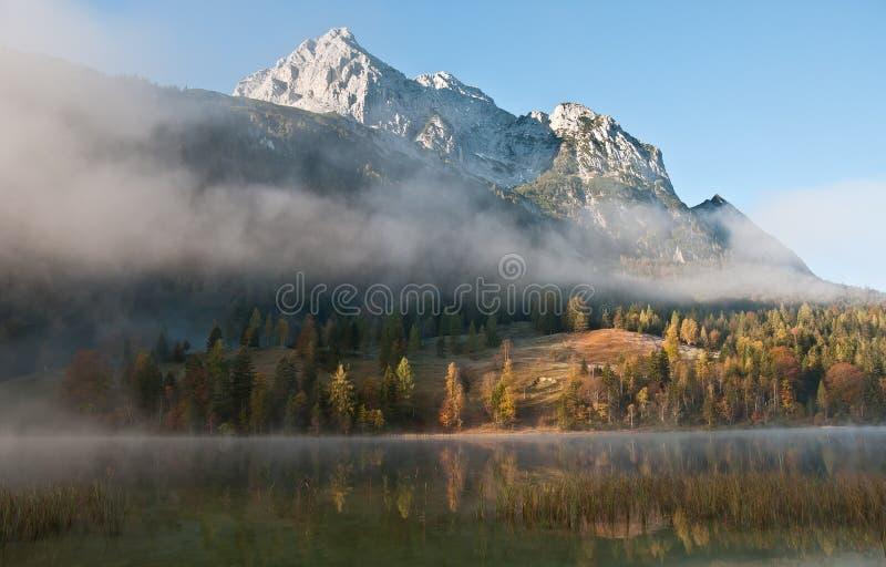 Morning mist in bavarian alps royalty free stock photo