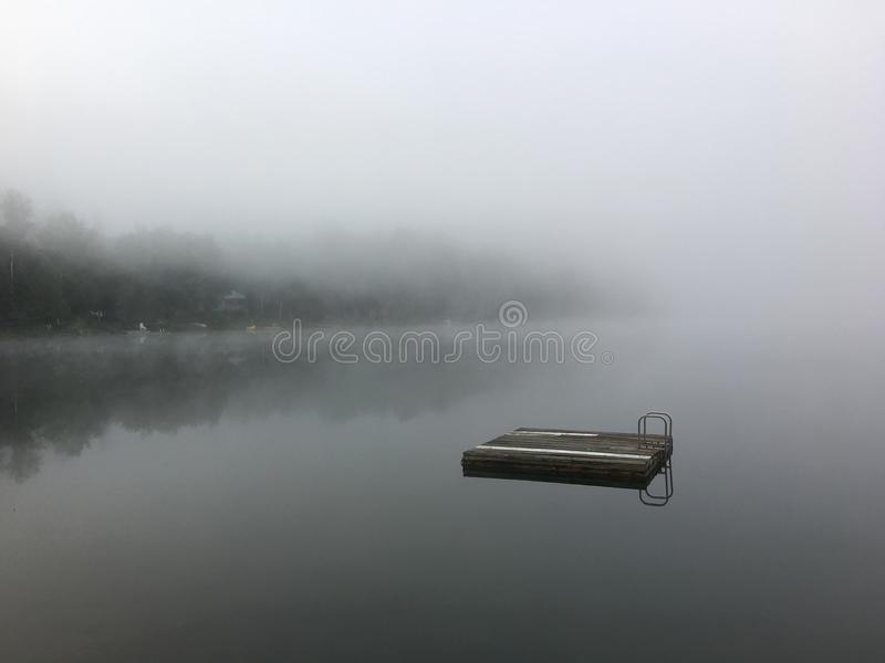 Morning mist on a lake stock photos