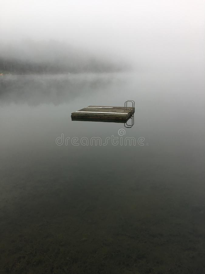 Morning mist on a lake stock photo
