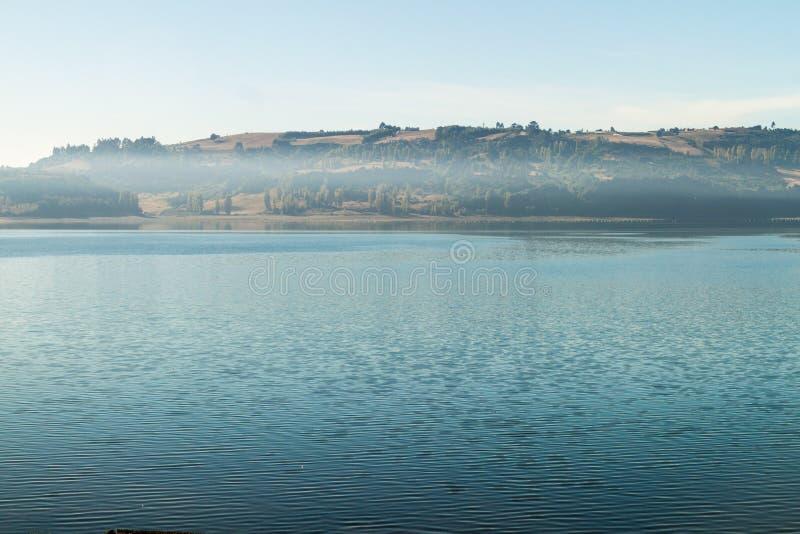 Morning mist on a sea in Castro, Chiloe island, Chi. Le stock photos