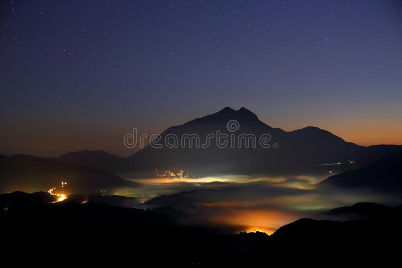 Morning mist of Yufuin and stars royalty free stock photo