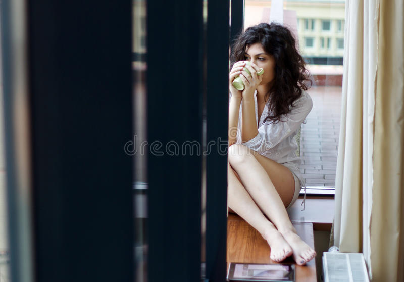 Morning mood. Young woman in the morning mood at home having a coffee stock photos