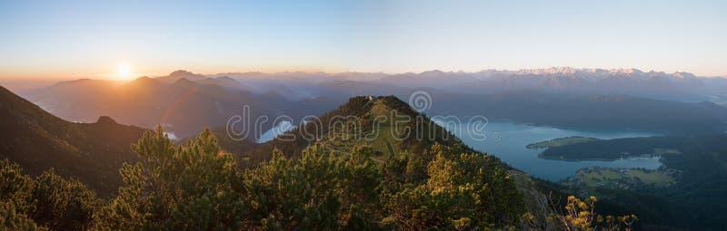 morning mood at martinskopf mountain, with rising sun and bavarian alps royalty free stock photography