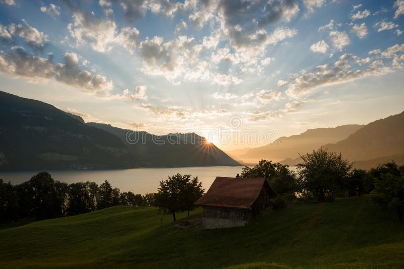 Morning mood over lake thun and mountains, bernese oberland royalty free stock photography