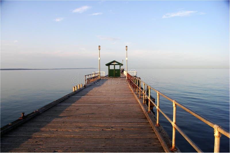 Morning, Mordialloc pier, Melbourne, Aust. Dead calm summer morning at Mordialloc pier, in the bayside area south-east of Melbourne, Victoria, Australia stock photos