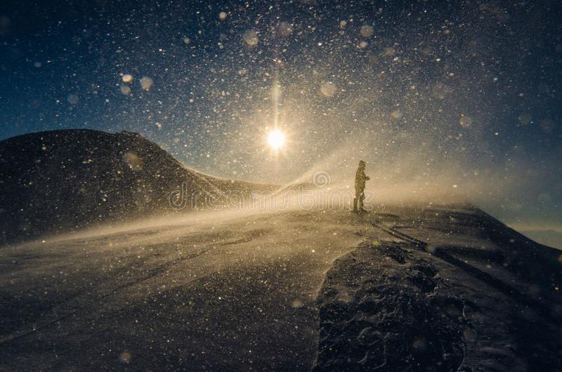 Man in snow storm royalty free stock photo