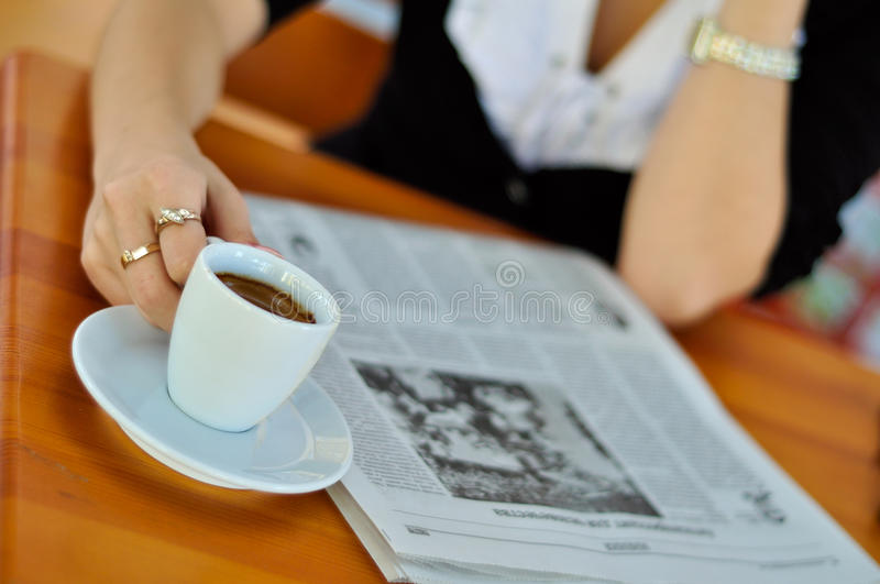 Some morning news and a cup of coffee stock images