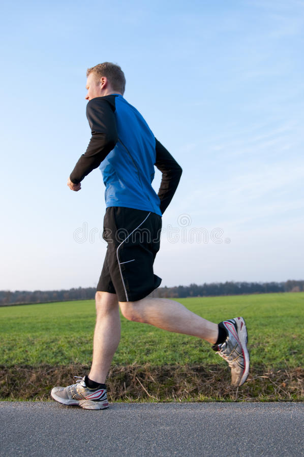 Morning outdoor jogging stock images