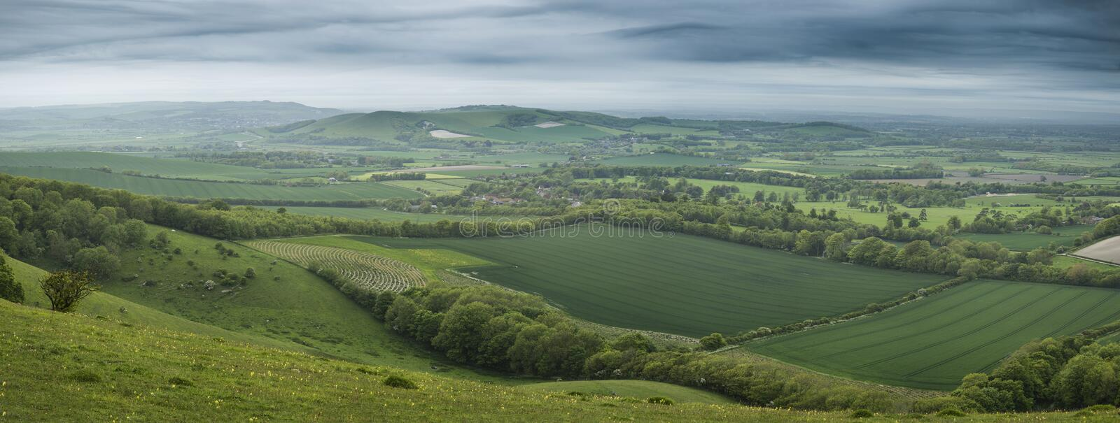Morning over rolling English countryside panorama landscape in S. Sunrise over rolling English countryside panorama landscape in Spring stock photos