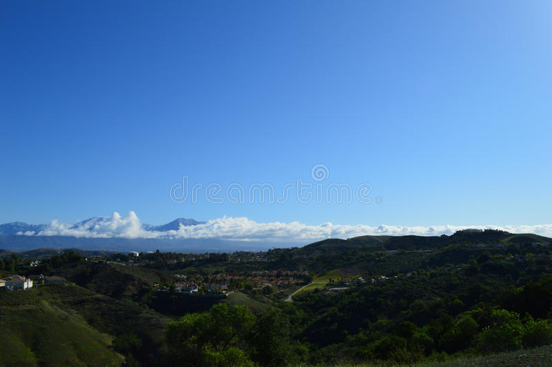 Morning Over San Gabriel Mountains and Valley. San Gabriel Valley and Snow Capped Mountains stock photo