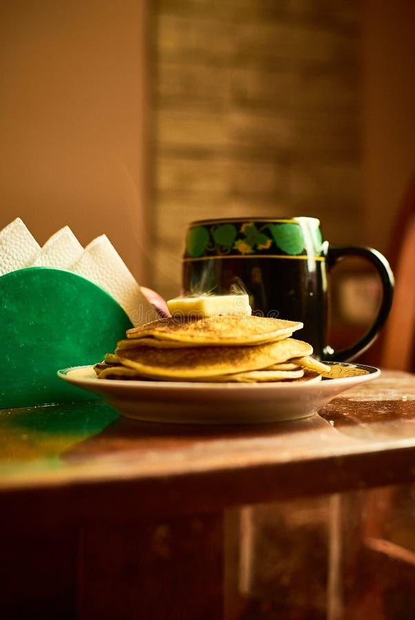 Morning pancakes with tea stock photos