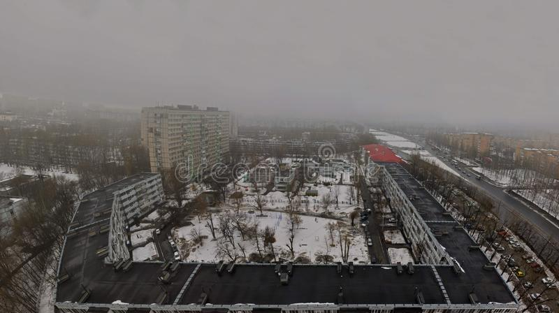 Morning panorama of the city of Togliatti against the background of spring fog. royalty free stock image