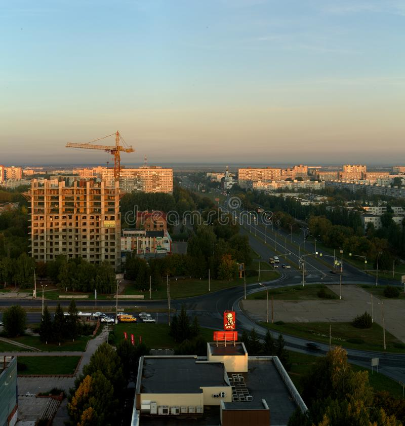 Morning panorama of the city of Togliatti with a view of the high-rise apartment building under construction. stock photos