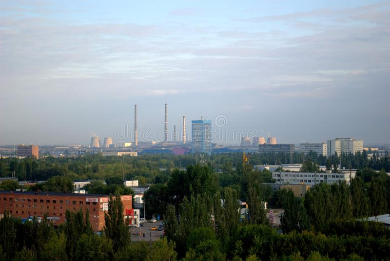 Morning panorama of the city of Togliatti with a view of the pipes and the building of the plant management of AVTOVAZ JSC. stock image