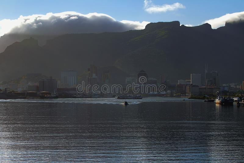 Morning of port city at mountain foot. Port Louis, Mauritius. 22-01-2016 royalty free stock photos