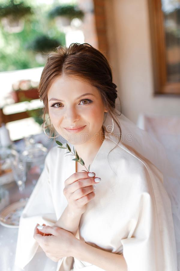 Morning portrait of the cute bride with branch royalty free stock photography