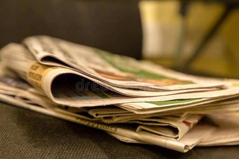 Morning press traditional breakfast businessman hot coffee stack of newspapers quotations fresh sports news royalty free stock photos