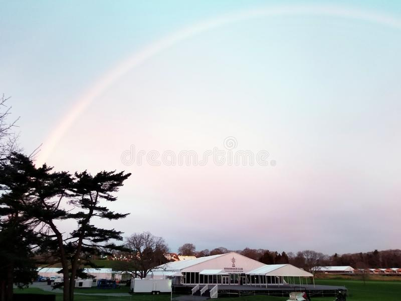 Morning Rainbow on the Bethpage Black Golf Course. In preparation for the upcoming 2019 Players Championship this rainbow was hosted by  the Bethpage Black royalty free stock images