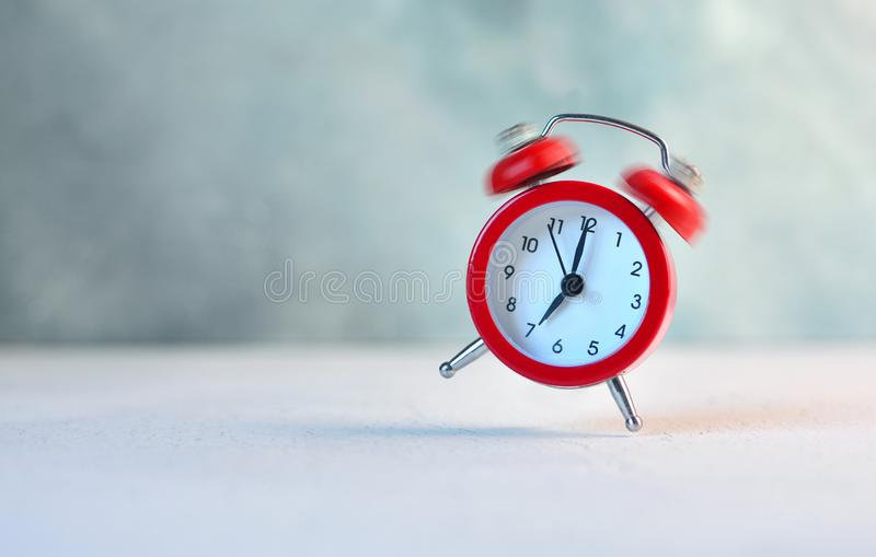 Morning. Ringing and bouncing red alarm clock background. royalty free stock images