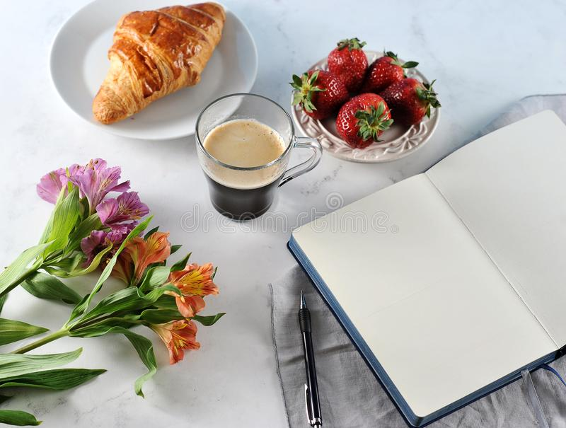 Morning romantic Breakfast - coffee mag, empty notebook royalty free stock image
