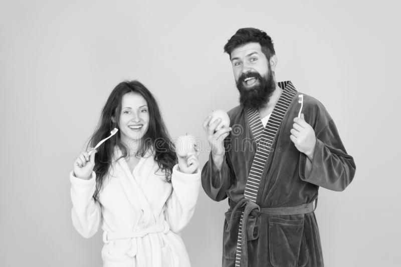 Morning routine. personal care and hygiene. Feeling happiness. couple in bathrobe clening teeth. man beard and girl royalty free stock image