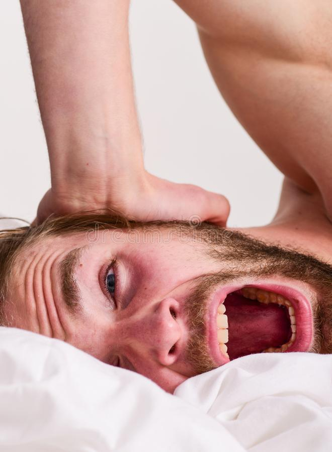Morning routine tips to feel good all day. Man handsome guy lay in bed in morning. Tips on how to wake up feeling fresh. And energetic. How to get up in morning royalty free stock photo