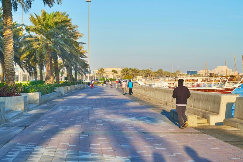 Sport activity in Doha, Qatar. The morning runners enjoy their training in seaside promenade of Doha, very popular destination for the sport activity, Qatar stock photo